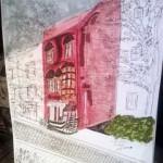 Une rue de Québec avec une maison rouge